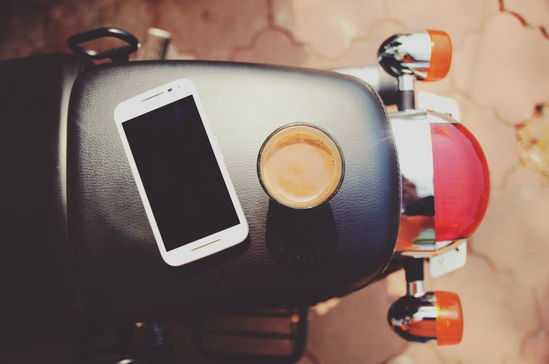iPhone sitting on seat of motorcycle